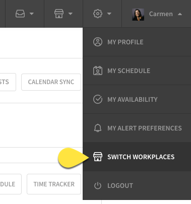 Hover over profile menu and select switch workplaces